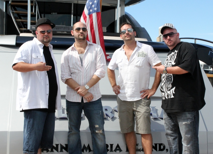 Two Headed Monster member (L) J.R. Rodriguez and (R) Robert 'BigSabs' Sabado on the ends with (L) Derek and (R) Marcus Ratzenboeck of BALE on set of Big Money Video Shoot aboard the '92 Yacht; Algorythm. Photo Credit: Larry Giorgio