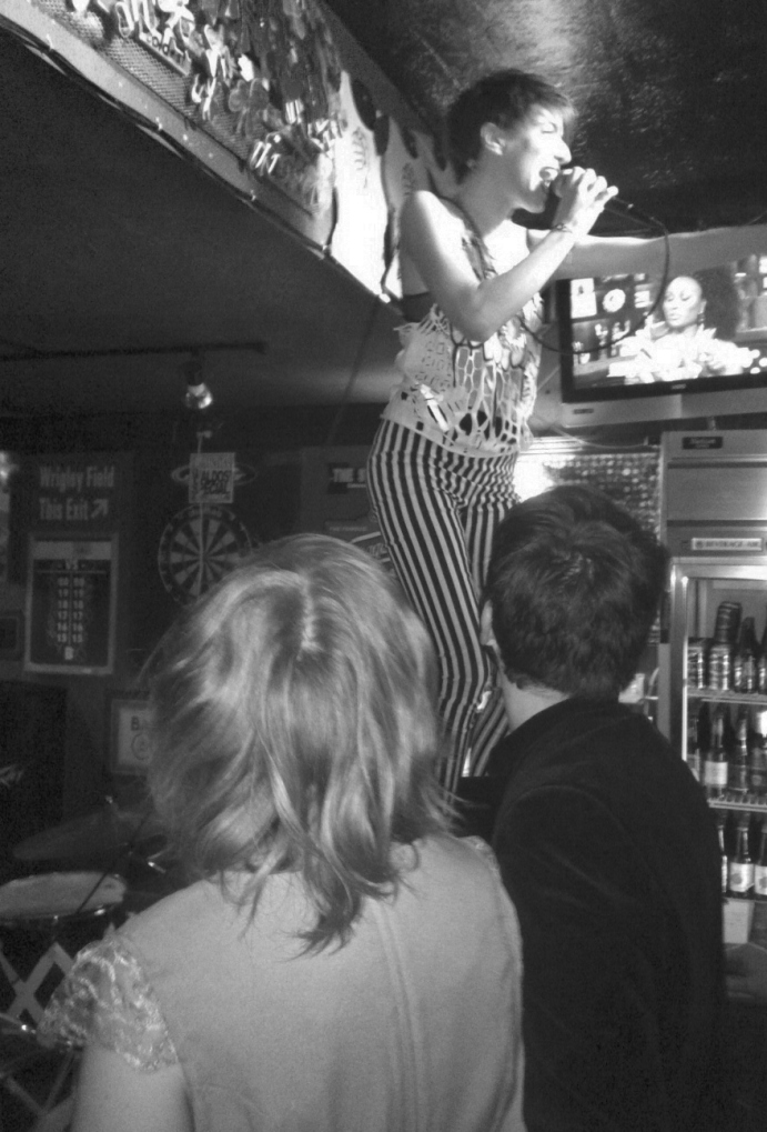 Cupcakes engaging the crowd as she uses the bar as an extension of her stage!