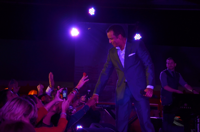 Jon Secada welcoming the crowd as he starts his show. Photo credit: InStudio E Phtography