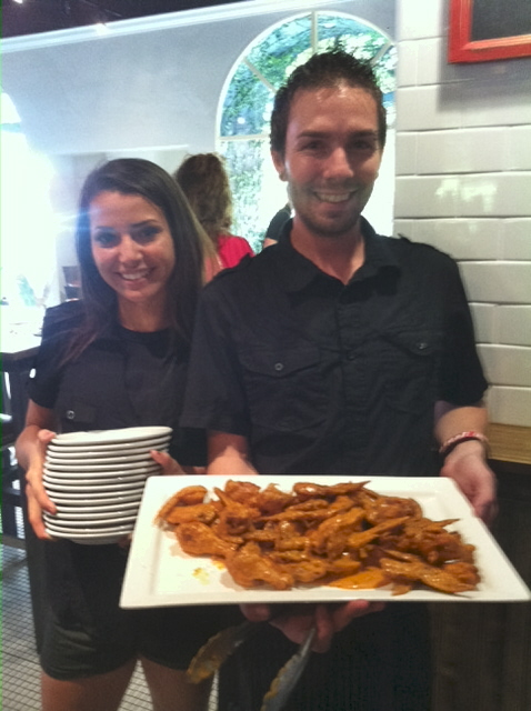 Clasico staff serving up chicken wings at Monday's event.