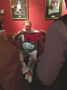 Bob Phillips; Scenic Designer receives a gift from the cast and crew after the show Opening Night.