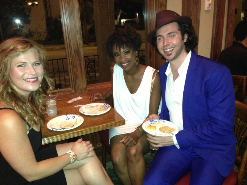(L) Carey Anderson, Taprena Michelle Augustine &  Peter Gosik enjoying snacks at the post party.